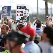 Various marchers carry signs during the Republican National Convention in Tampa, Fla. on Wednesday, August 29, 2012. (AP Photo/Alex Menendez)