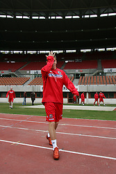 VIENNA, AUSTRIA - TUESDAY MARCH 29th 2005: Wales' Craig Bellamy walks out for a training session at the Ernst Happel Stadium ahead of their World Cup Qualifying Group Six match against Austria. (Pic by David Rawcliffe/Propaganda)