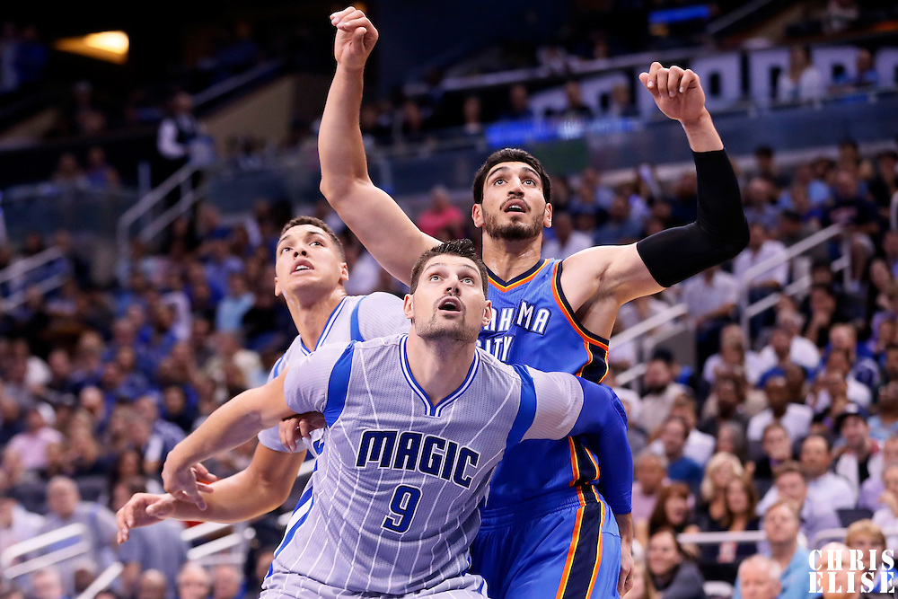 30 October 2015: Orlando Magic center Nikola Vucevic (9) vies for the rebound with Oklahoma City Thunder center Enes Kanter (11) during the Oklahoma City Thunder 139-136 double overtime victory over the Orlando Magic, at the Amway Center, in Orlando, Florida, USA.