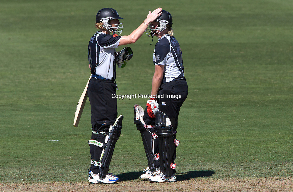 Sydney-March 17:  Captain Haidee Tiffen congratulates Kate Pulford (right) during the match between New Zealand and India in the Super 6 stage of the ICC Women's World Cup Cricket tournament at North Sydney  Oval, Sydney, Australia on March 17, 2009. New Zealand beat India by 5 wickets. Photo by Tim Clayton.