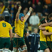Australian Captain James Horwill and the Australian team celebrate victory at the final whistle during the South Africa V Australia Quarter Final match at the IRB Rugby World Cup tournament. Wellington Regional Stadium, Wellington, New Zealand, 9th October 2011. Photo Tim Clayton...