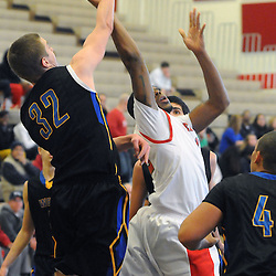 Staff photos by Tom Kelly IV<br /> Coatesville's Jaquan Hollingshed (12) gets his layup blocked by Downingtown West's Josh Warren (32) during the Downingtown West at Coatesville boys basketball game on Saturday afternoon January 4, 2014.