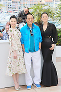 "CANNES, FRANCE - MAY 20:  Huiwen Zhang, Yimou Zhang and Gong  Li attends the ""Coming Home"" photocall at the 67th Annual Cannes Film Festival on May 20, 2014 in Cannes, France.  (Photo by Tony Barson/FilmMagic)"