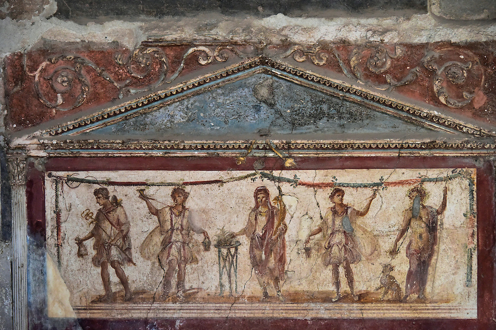 Fresco of Greek Gods at Thermopolium in Pompeii, Italy <br /> Imagine you are strolling along Via dell&rsquo; Abbondanza during the mid-1st century and it is dinnertime. You might stop at the Thermopolium of Vetutius Placidus and be served from the marble countertop facing the street. This fresco (called a lararium) adorns the wall. The two Greek deities shown at either end seem perfect for a bar/restaurant. On the right is Bacchus, the god of wine. On the left is Mercury (also named Hermes) who is the god of commerce and profit.