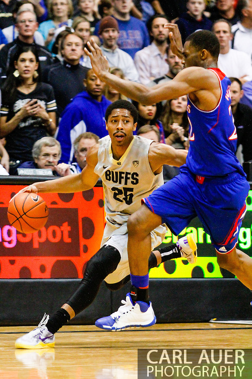 December 7th, 2013:  Colorado Buffaloes junior guard Spencer Dinwiddie (25) drives the ball past Kansas Jayhawks freshman guard Andrew Wiggins (22) in the second half of the NCAA Basketball game between the Kansas Jayhawks and the University of Colorado Buffaloes at the Coors Events Center in Boulder, Colorado