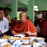 "May 14, 2013 - Mandalay, Myanmar: Ashin Wirathu, the buddhist monk leader of Burma's anti-Muslim movement 969 group, takes the traditional midday meal offered by regular citizens at Mosayein Monastery in central Mandalay. Wirathu, who was jailed in 2003 for inciting religious hatred, refers to himself as ""the Burmese Bin Laden"". CREDIT: Paulo Nunes dos Santos"
