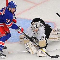 Pittsburgh Penguins goalie Marc-Andre Fleury (29) ices a lose puck in front of his crease before New York Rangers right wing Ryan Callahan (24) can reach it during third period NHL action between the New York Rangers and Pittsburgh Penguins at Madison Square Garden in New York, NY. The Rangers defeated the Penguins 4-3.
