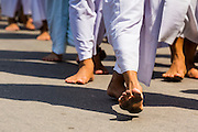 24 MAY 2013 - MAE SOT, THAILAND: Members of the Burmese emigre community in Mae Sot, Thailand, walk barefoot in a procession for Visakha Puja Day. Visakha Puja (Vesak) marks three important events in the Buddha's life: his birth, his attainment of enlightenment and his death. It is celebrated on the full moon of the sixth lunar month, usually in May on the Gregorian calendar. This year it is on May 24 in Thailand and Myanmar. It is celebrated throughout the Buddhist world and is considered one of the holiest Buddhist holidays. Burmese Buddhist in Mae Sot celebrated with a procession through Mae Sot that ended with a service followed by a communal meal at Wat Pha Mai, the most important Burmese Buddhist temple in Mae Sot.     PHOTO BY JACK KURTZ