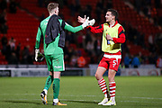 Doncaster Rovers goalkeeper Ian Lawlor (1) and Doncaster Rovers defender Mathieu Baudry (5) shake at the end of the game,  after their mix costs Doncaster Rovers a goal to make the score 2-1 during the EFL Sky Bet League 1 match between Doncaster Rovers and Portsmouth at the Keepmoat Stadium, Doncaster, England on 17 October 2017. Photo by Simon Davies.