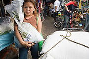 08 JANUARY 2007 - MANAGUA, NICARAGUA: A woman shops in Mercado Oriental, the main market that serves Managua, Nicaragua. The market encompasses dozens of square blocks and is the largest market in Central America.    PHOTO BY JACK KURTZ