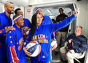 "The Harlem Globetrotters' Tammy ""T-Time"" Brawner takes a group self portrait inside the moving Atlanta Streetcar as the team visits downtown sights on the streetcar's 2.7-mile route Monday, March 9, 2015, in Atlanta. David Tulis / AJC Special"