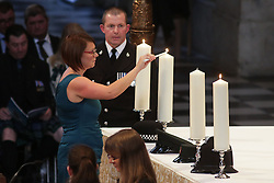 Candles are lit during the service to commemorate National Police Memorial Day at St. Paul's cathedral in central London.