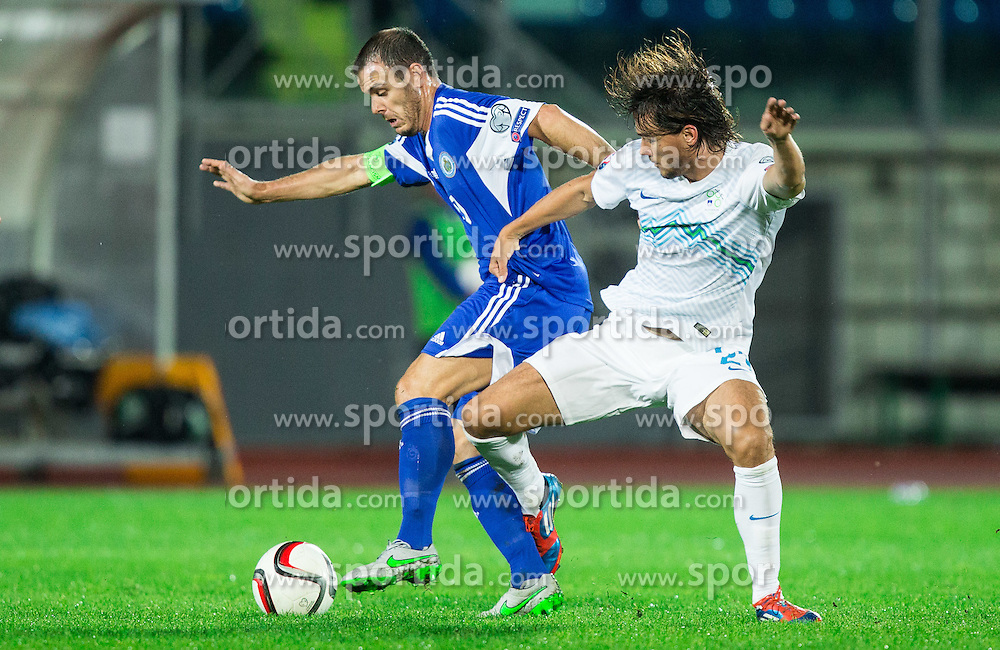 Andy Selva of San Marino vs Rene Krhin of Slovenia during football match between National teams of San Marino and Slovenia in Group E of EURO 2016 Qualifications, on October 12, 2015 in Stadio Olimpico Serravalle, Republic of San Marino. Photo by Vid Ponikvar / Sportida