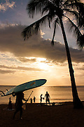 Stand-up paddle board surfer with board at surset