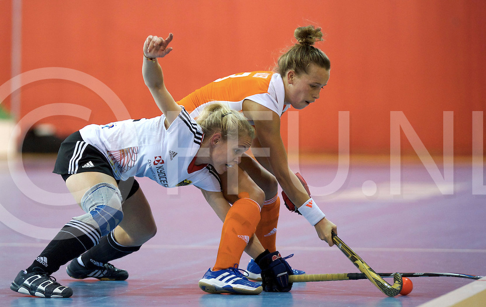 Prague - EuroHockey Indoor Championship (W) 2014<br /> 07 NED v GER (Pool B )<br /> foto: Lydia Haase duel with Lieke Hulsen.<br /> FFU PRESS AGENCY COPYRIGHT FRANK UIJLENBROEK