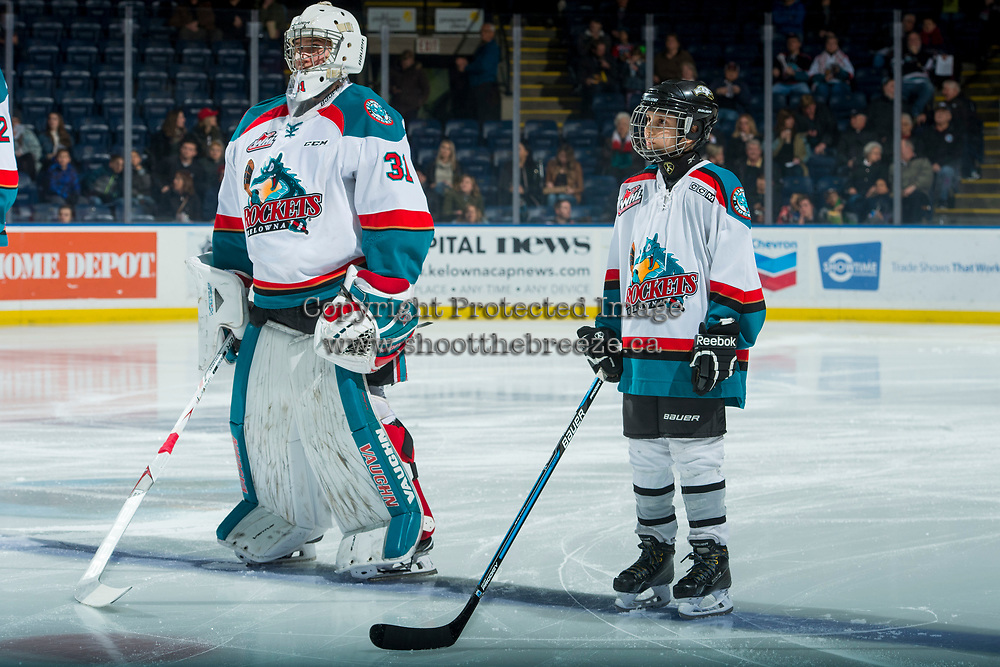 KELOWNA, CANADA - FEBRUARY 20:  Brodan Salmond #31 of the Kelowna Rockets lines up with the Pepsi Player on the blue line against the Prince George Cougars on February 20, 2018 at Prospera Place in Kelowna, British Columbia, Canada.  (Photo by Marissa Baecker/Shoot the Breeze)  *** Local Caption ***