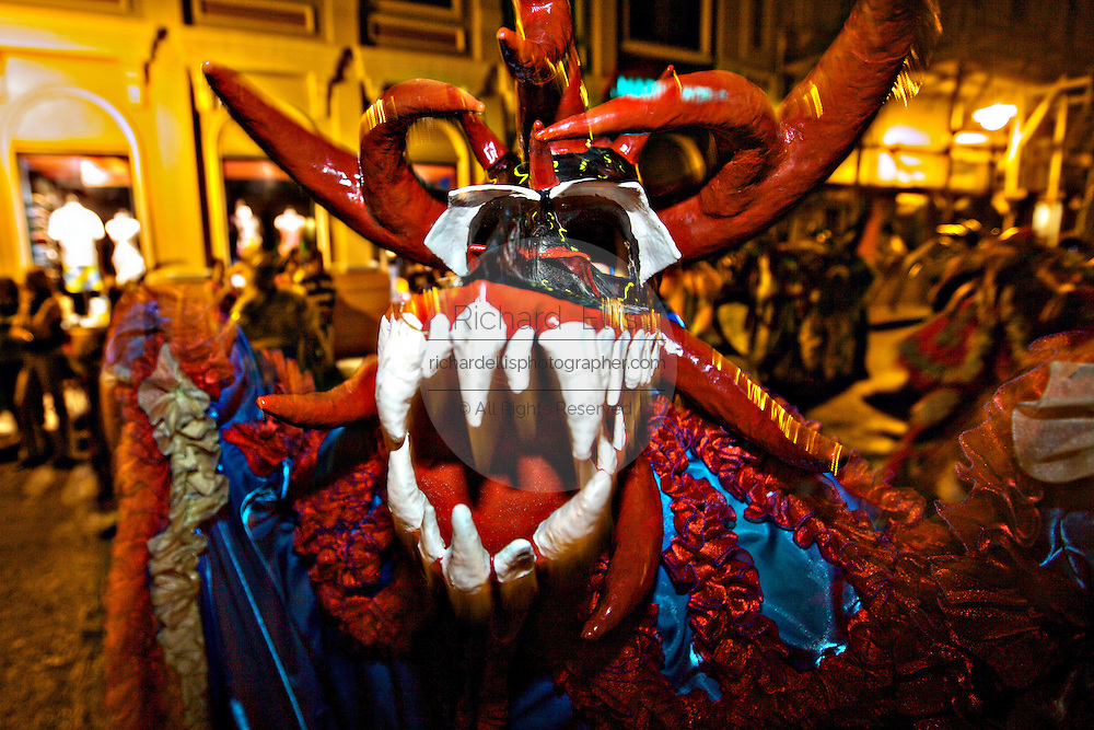 A costumed reveler called vejigante dances in the streets during the Carnaval de Ponce February 21, 2009 in Ponce, Puerto Rico. Vejigantes are a folkloric character representing the devil.