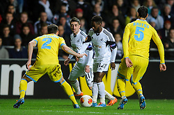 Swansea Midfielder Nathan Dyer (ENG) is challenged by Napoli Defender Anthony Reveillere (FRA) and Defender Miguel Angel Britos (URU) - Photo mandatory by-line: Rogan Thomson/JMP - Tel: 07966 386802 - 20/02/2014 - SPORT - FOOTBALL - Liberty Stadium, Swansea -  Swansea City v SSC Napoli - UEFA Europa League, Round of 32, First Leg.