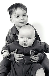 Studio portrait of small boy & baby UK 1990s
