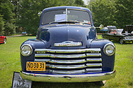 Old Westbury, New York, USA. June 2, 2019. The antique 1951 blue Chevrolet pickup truck, owned by Debbie Dugan of Glen Head, is an antique car entry on display at the 53rd Annual Spring Meet Antique Car Show, sponsored by the Greater NY Region (NYGR) of the Antique Automobile Club of America (AACA), at Old Westbury Gardens, a Long Island Gold Coast estate.