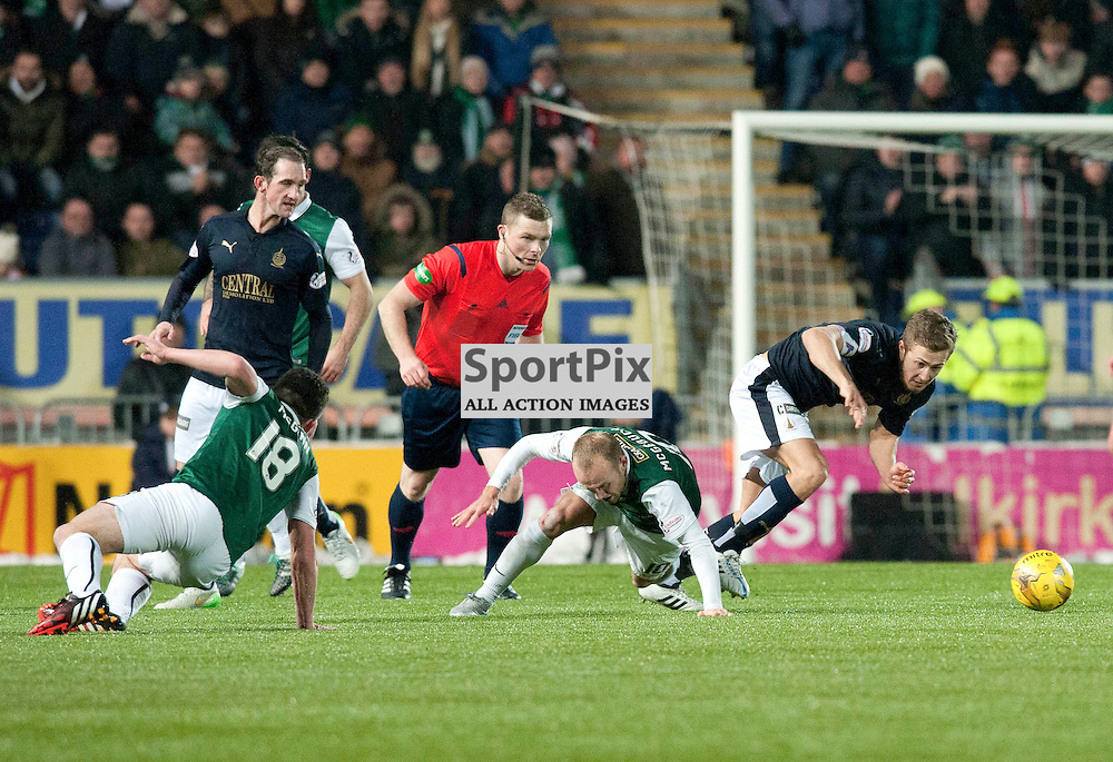 Dylan McGeouch slides in to tackle Craig Sibbald during the Ladbrokes Championship match between Falkirk v Hibs, The Falkirk Stadium, Sunday 17 January 2016 (c) Angie Isac | SportPix.org.uk