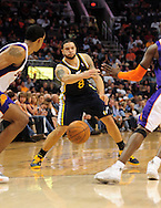 Feb. 15, 2011; Phoenix, AZ, USA; Utah Jazz guard Deron Williams (8) makes a pass against the Phoenix Suns at the US Airways Center.  The Suns defeated the Jazz 102-101. Mandatory Credit: Jennifer Stewart-US PRESSWIRE