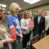 Lisa Reed, center, and others annouce this year's book, Cinny Moon, for the annual Tupelo Reads book at the Lee County Library Monday afternoon. Later this year the author Benjamin Ludwig will be in Tupelo to speak about the book.