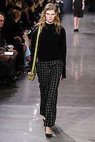 Alexandra Elizabeth walks the runway wearing Jason Wu Fall 2016, Hair by Paul Hanlon for Morocconoil, Makeup by Yadim for Maybelline, shot by Thomas Concordia during New York Fashion Week on February 12, 2016