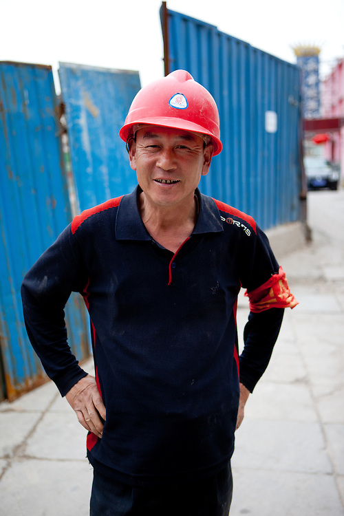 Portrait of a construction worker  in central Beijing. Beijing is the capital of the People's Republic of China and one of the most populous cities in the world with a population of 19,612,368 as of 2010.