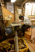 Masahara Nakajima, owner of Nakajima Seikichi Shoten, shaping wood when making shogi playing pieces. Tendo, Yamagata Prefecture, Japan, February 19, 2018. The city of Tendo in Yamagata Prefecture is famous for its shogi (Japanese chess) playing pieces. Production started early in the 19th century and Tendo still produces over 95% of the Shogi pieces made in Japan.