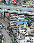 GUIYANG, CHINA - (CHINA OUT) <br /> <br /> Living Under The Bridge<br /> Residential buildings are seen under the Shuikousi bridge  in Guiyang, Guizhou Province of China. There are more than ten residential buildings under the Shuikousi bridge. The bridge was completed in May 1997, and the residential buildings were completed two years later as low-rent housing and resettlement housing projects. <br /> ©Wang Pingping/Exclusivepix