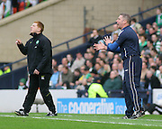 Celtic coach Neil Lennon and Rangers' assistant boss Ally McCoist animated on the touchline during the League Cup final between Rangers and Celtic at Hampden Park -<br /> David Young Universal News And Sport