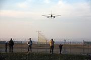 An airplane is landing at Malpensa airpot, Lonate Pozzolo. © Carlo Cerchioli..Un aereo sta atterrando all'aeroporto Malpensa...