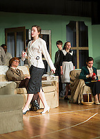 "Wanda Henrietta Blore played by Emily Paronto walks past  Phillip Lombard (John Hammond) and Emily Caroline Brent (Zina LaBrie) during Laconia High School's dress rehearsal for Agatha Christie's ""And Then There Were None...."" Wednesday evening.  (Karen Bobotas/for the Laconia Daily Sun)"