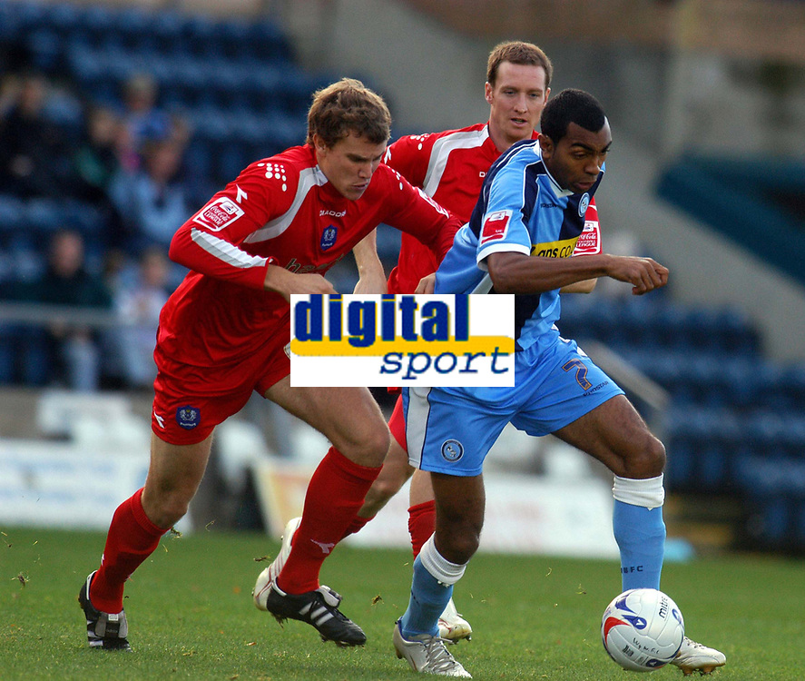 Photo: Alan Crowhurst.<br />Wycombe Wanderers v Peterborough United. Coca Cola League 2. 21/10/2006. Wycombe's Kevin Betsy (R) attacks.