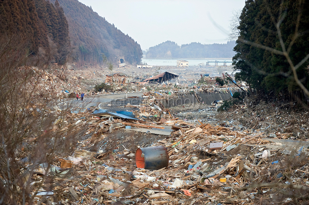 Shattered homes and other debris that was swept inland by the tsunami that followed the March 11 magnitude 8.8 quake are all that remain of the coastal area of Minami Sanriku Town, Miyagi Prefecture, Japan on 13 March, 2011. Some 10,000 people out of the town's population of  17,666 are reported as missing following the 10-meter-high wave that struck the village. Photographer: Robert Gilhooly