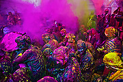 People of Braj Region of Mathura, celebrating,Holi, 'the festival of colors' in Barsana Village of India.<br /> <br /> People sit together and sing and abuse each other in braj language while others throw colored powder and water on them.