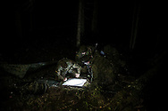 Cadets during the night training session in a forest located in Central Lithuania.