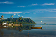 Boat moored on calm morning on Kaneohe Bay, Hawaii