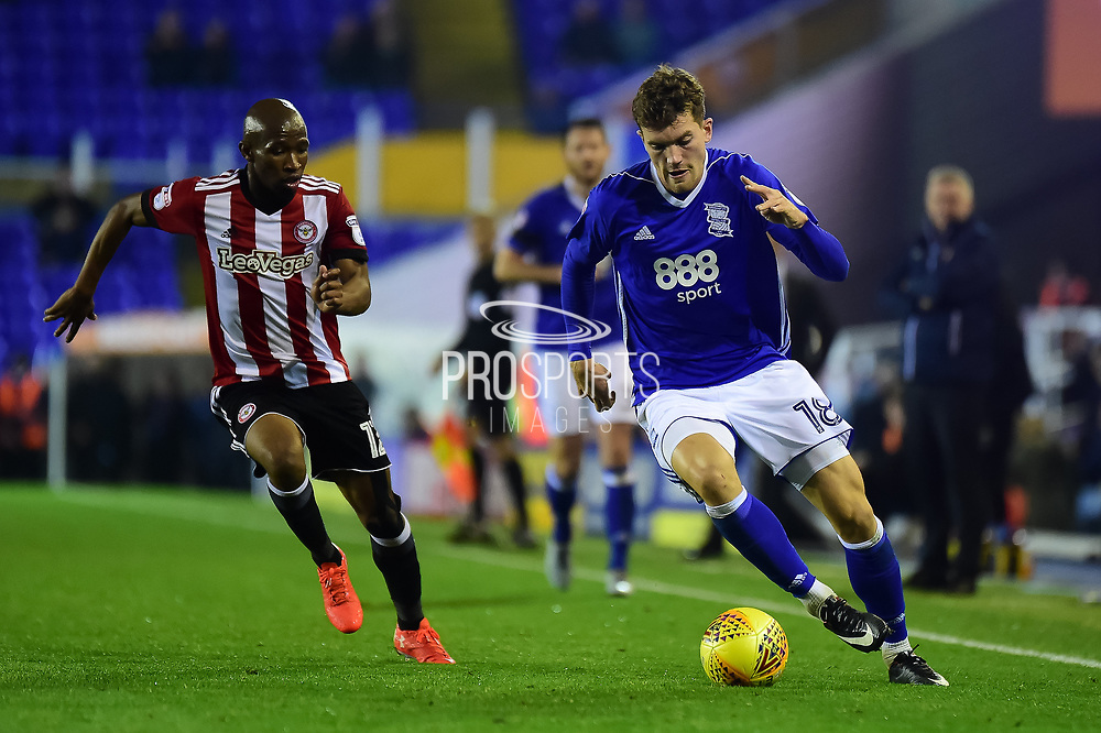 Brentford FC midfielder Alan Judge (18) sprints forward with the ball under pressure from Brentford FC midfielder Kamohelo Mokotjo (12) during the EFL Sky Bet Championship match between Birmingham City and Brentford at St Andrews, Birmingham, England on 1 November 2017. Photo by Dennis Goodwin.