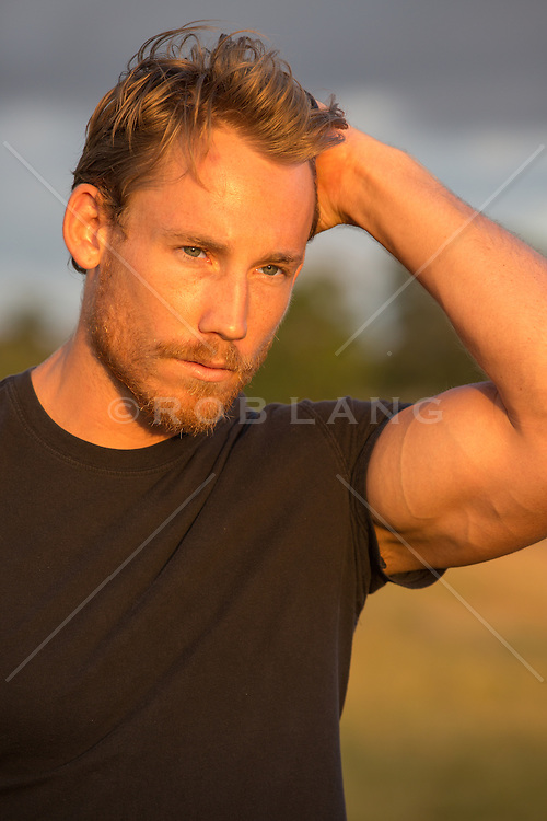 handsome chiseled man with a beard outdoors