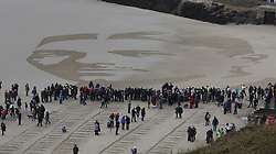 © Licensed to London News Pictures. 11/11/2018. Folkestone, UK. A giant sand portrait of First World War poet Wilfred Owen is revealed on the beach at Folkestone, Kent during an Armistice Centenary event entitled 'Pages of the Sea'. Portraits are being created by communities on 32 beaches around the UK to say goodbye and thank you, to the millions of men and women who left these shores during the war, many never to return. Lieutenant Wilfred Edward Salter Owen, MC died on 4th November 1918 only days before the Armistice. One of Britain's most celebrated war poets - his short career was directly inspired by the conflict – he composed nearly all his works from August 1917 to September 1918, many published posthumously. Photo credit: Peter Macdiarmid/LNP