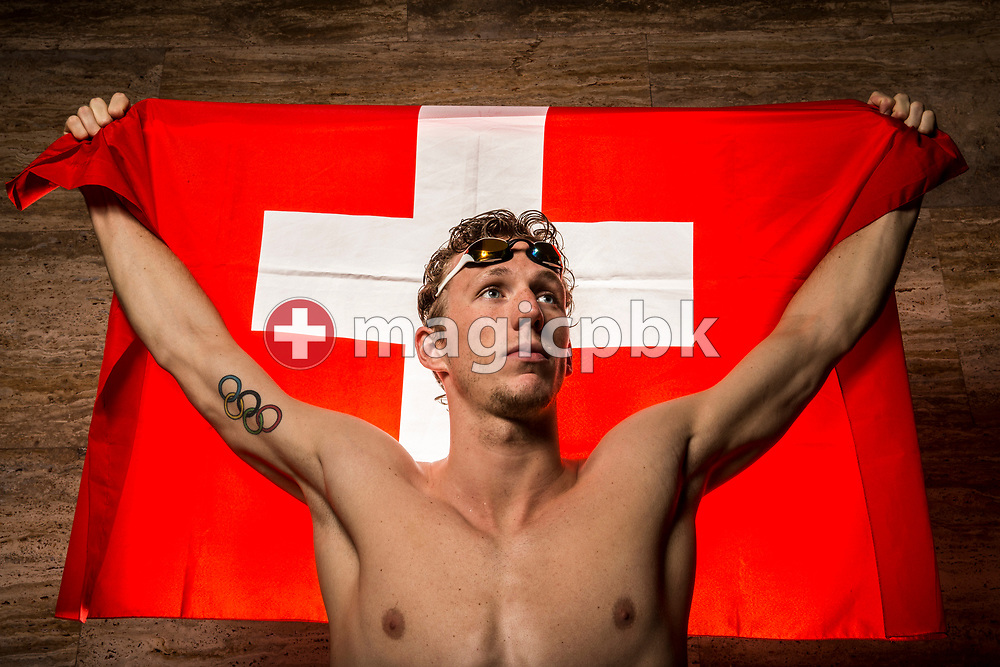 Swimmer Jeremy DESPLANCHES of Switzerland poses with a Swiss flag for a portrait during a photo session during the Swiss Swimming Championships at the Piscine des Vernets in Geneva, Switzerland, Sunday, March 26, 2017. (Photo by Patrick B. Kraemer / MAGICPBK)