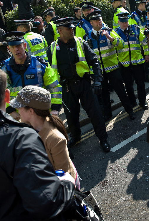 London April 2nd 2009 (FILE IMAGE)  Picture shows an officer with his number hidden just seconds before allegedly swiping at the woman ( In the pic with cap) with the back of his hand and in the legs with the extendeble baton...***Standard Licence  Fee's Apply To All Image Use***.Marco Secchi /Xianpix. tel +44 (0) 845 050 6211. e-mail ms@msecchi.com or sales@xianpix.com.www.marcosecchi.com A police officer will be charged with assaulting a woman during the G20 demonstrations in London, the Crown Prosecution Service has said.Sergeant Delroy Smellie has been ordered to appear in court over the beating of Nicola Fisher.<br /> <br /> Prosecutors have decided there is &quot;sufficient evidence&quot; for him to be charged.