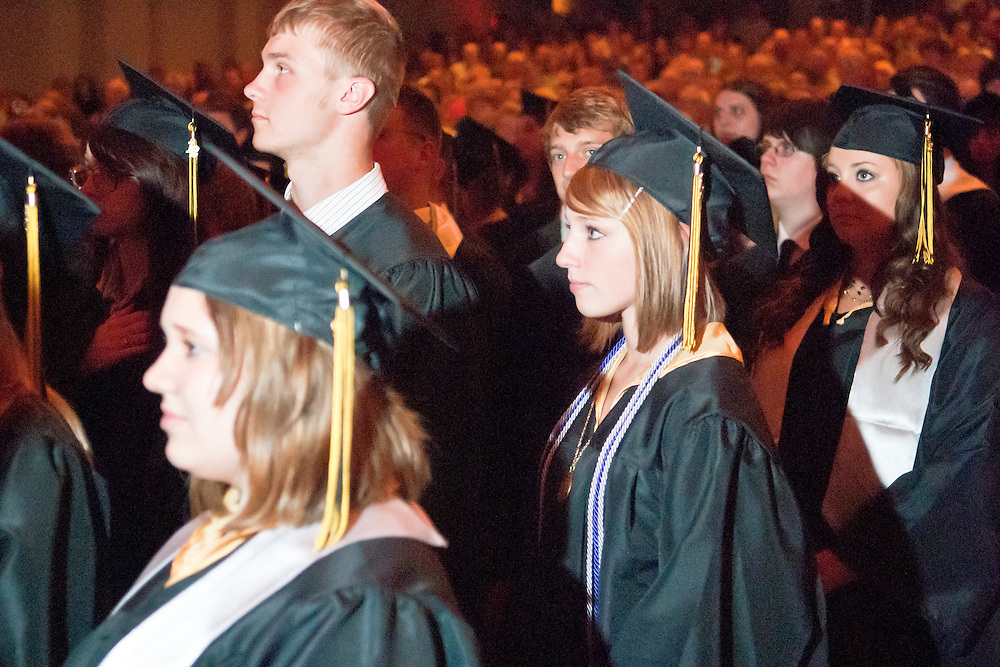 Lathan Goumas | MLive.com..Graduates stand during the playing of the National Anthem during the LakeVille Memorial High School commencement ceremony at the Whiting Theater in Flint, Mich. on Wednesday June 6, 2012.