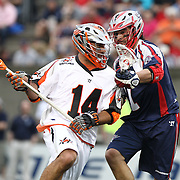 Justin Pennington #14 of the Denver Outlaws controls the ball during the game at Harvard Stadium on May 10, 2014 in Boston, Massachusetts. (Photo by Elan Kawesch)