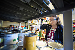 A volunteer working in a food bank.
