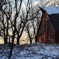 The setting sun illuminates the old barn on the property of Good Earth State Park at Blood Run on Wednesday, Dec. 18, 2013 in southeast South Dakota.