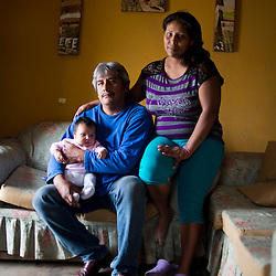 Herbert Ipanaque Coronado (5 years in El Ayllu)  Roxana Sanchez Cabrera (27 years old and in El Ayllu since birth) and their baby Nahiara (a month old)