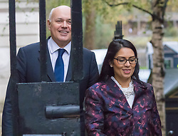 Downing Street, London, November 24th 2015. Work and Pensions Secretary Iain Duncan-Smith arrives with Employment Minister Priti Patel at Downing Street for the weekly cabinet meeting. ///FOR LICENCING CONTACT: paul@pauldaveycreative.co.uk TEL:+44 (0) 7966 016 296 or +44 (0) 20 8969 6875. ©2015 Paul R Davey. All rights reserved.